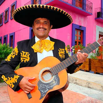 Charro Mariachi singer playing guitar in Mexico houses shutterstock 75356785 6675