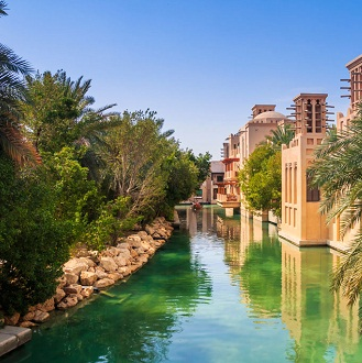 Scenic boat on green water canals in the city of Dubai shutterstock 322890356 9851